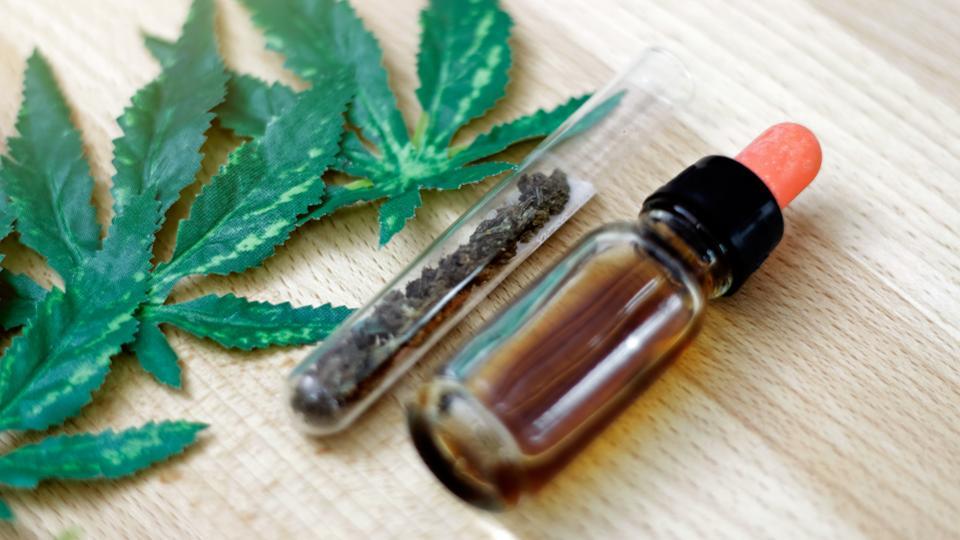 CBD bottle and leaf